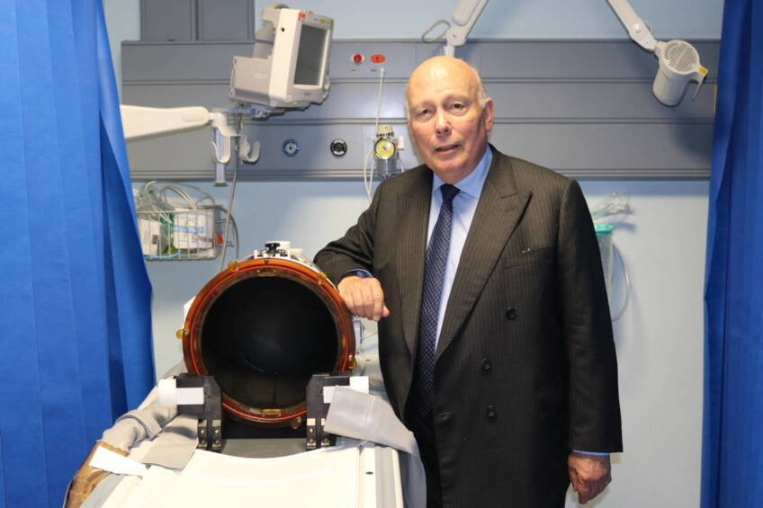 Downton Abbey creator visits charity-funded 'miracle' cure for tremor patients